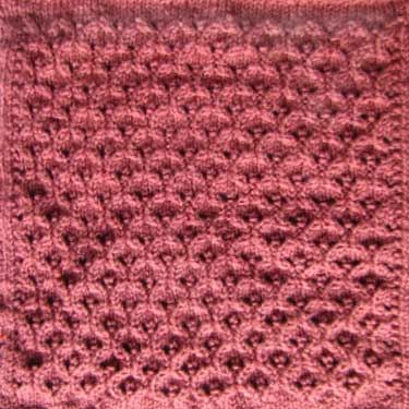 Knitted Afghan Square Patterns : Knitted quilt squares - Hourglass Eyelets pattern